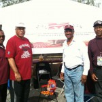 Morehouse track and field alumni in front of the foundation's 2012 homecoming tent. L to R, Napoleon Cobb, David Walker, Walter Mason, and John Jones.