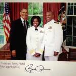 President Barack Obama, CDR Shaun Hand CAU C/O 1995 and CDR Bobby Hand.