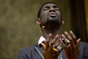 """Carvens Lissaint delivers the evening's sermon, """"Break Every Chain (A Call for Freedom)."""" Lissaint, of New York, is an award-winning Haitian American performance artist and teacher. (Phyllis Graber Jensen/Bates College)"""